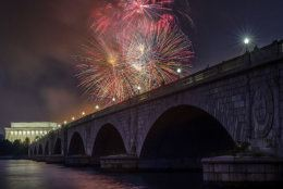 Fireworks burst over the Memorial Bridge and Lincoln Memorial during Independence Day celebrations on the National Mall in Washington, Tuesday, July 4, 2017. (AP Photo/J. David Ake)