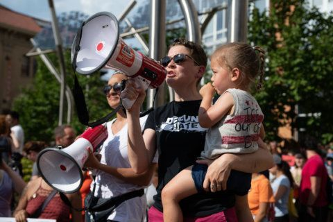 Community members rally on hot afternoon against ICE raids in DC