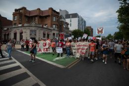 """D.C. immigrant advocacy groups and their allies rallied in Columbia Heights and Adams Morgan on June 29, 2019, demanding Mayor Muriel Bowser and the D.C. Council enforce the city's status as a """"sanctuary city"""" and not cooperate with federal law enforcement in detaining undocumented migrants. (WTOP/Alejandro Alvarez)"""