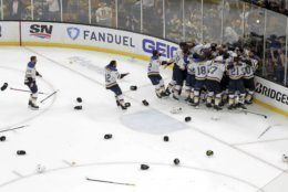 The St. Louis Blues celebrate their win over the Boston Bruins in Game 7 of the NHL hockey Stanley Cup Final, Wednesday, June 12, 2019, in Boston. (AP Photo/Charles Krupa)