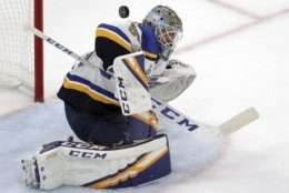 St. Louis Blues goaltender Jordan Binnington turns a shot away during the second period in Game 7 of the NHL hockey Stanley Cup Final against the Boston Bruins, Wednesday, June 12, 2019, in Boston. (AP Photo/Charles Krupa)