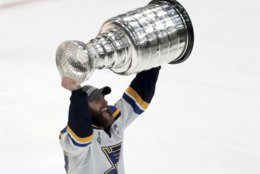 St. Louis Blues' Alex Pietrangelo carries the Stanley Cup after the Blues defeated the Boston Bruins in Game 7 of the NHL Stanley Cup Final, Wednesday, June 12, 2019, in Boston. (AP Photo/Charles Krupa)