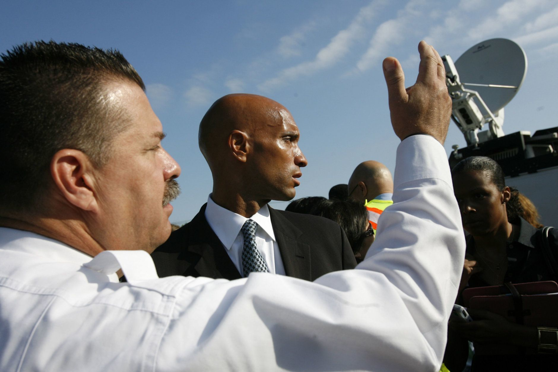 Washington Fire Chief Dennis Rubin, left, and Washington Mayor Adrian Fenty are seen near the site in Washington, Tuesday, June 23, 2009, where two metro trains collided Monday. (AP Photo/Jacquelyn Martin)