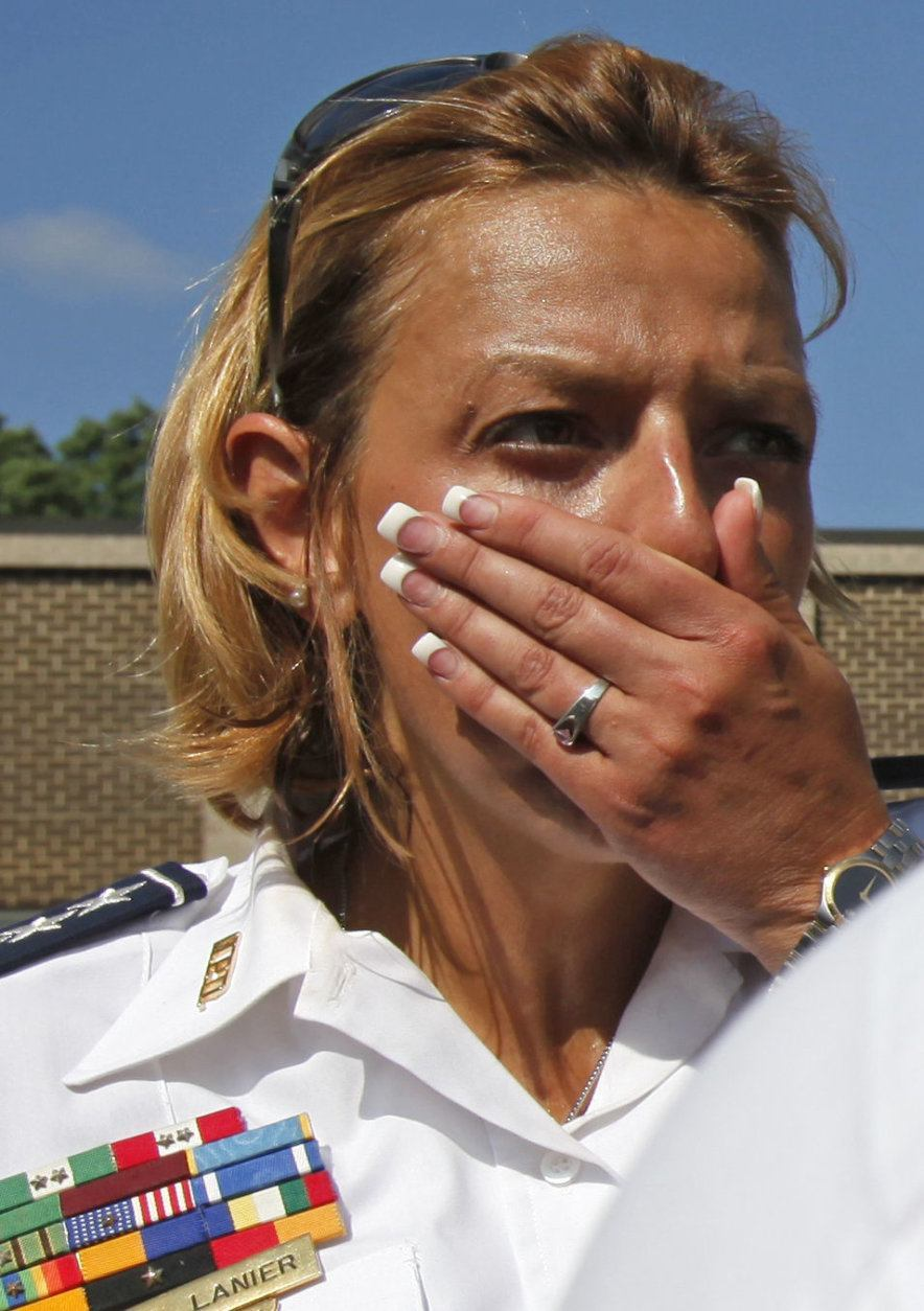 Washington Police Chief Cathy Lanier finishes a tour of the accident site in Washington, Tuesday, June 23, 2009, where two metro trains collided Monday. (AP Photo/Jacquelyn Martin)