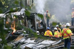 Officials continue to work around the scene of a rush-hour collision between two Metro transit trains in northeast Washington, D.C., Tuesday evening, June 23, 2009  (AP Photo/Jacquelyn Martin)