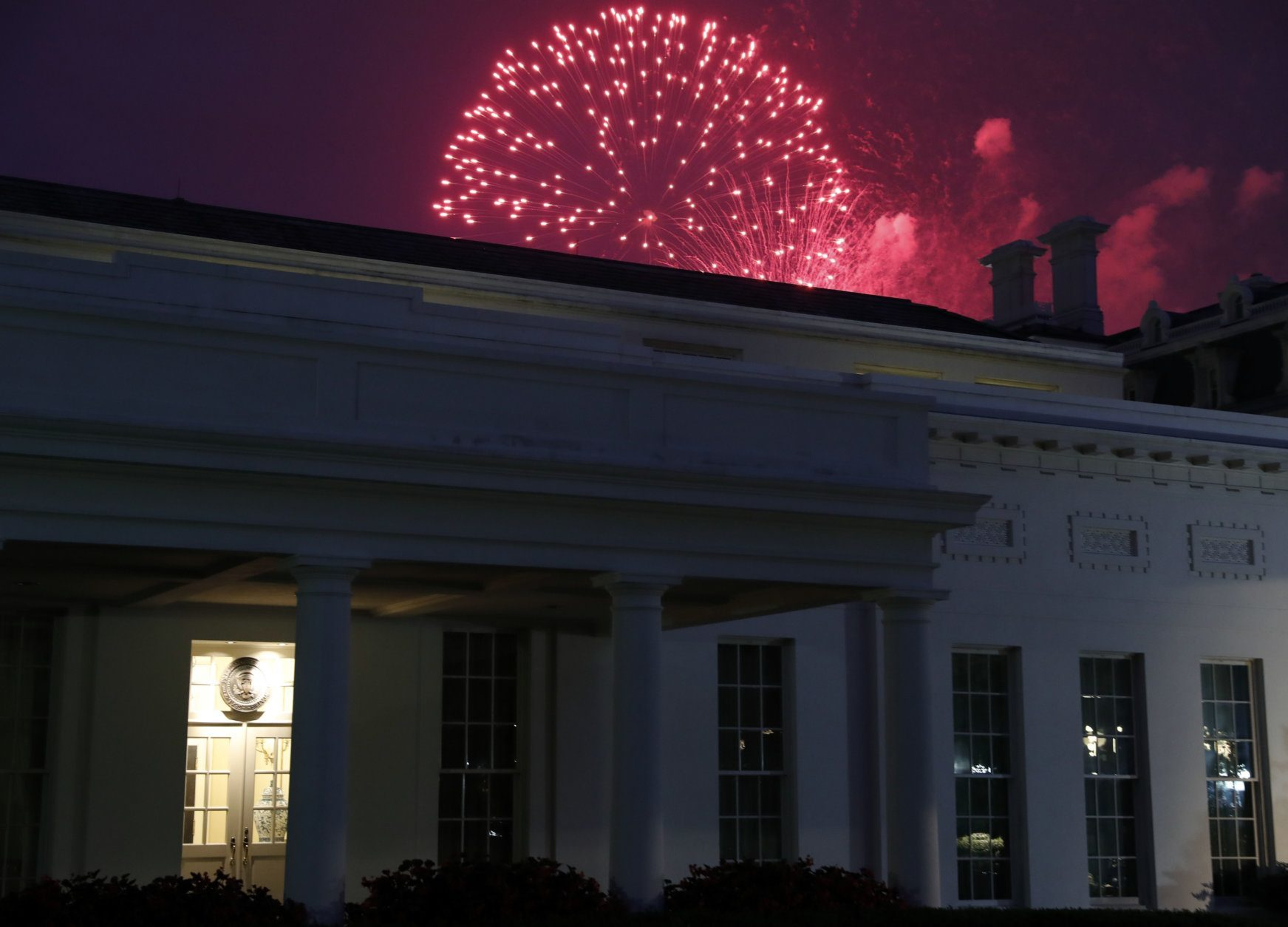 Fireworks explode over the West Wing of the White House for the Fourth of July holiday, Tuesday, July 4, 2017, in Washington. (AP Photo/Alex Brandon)