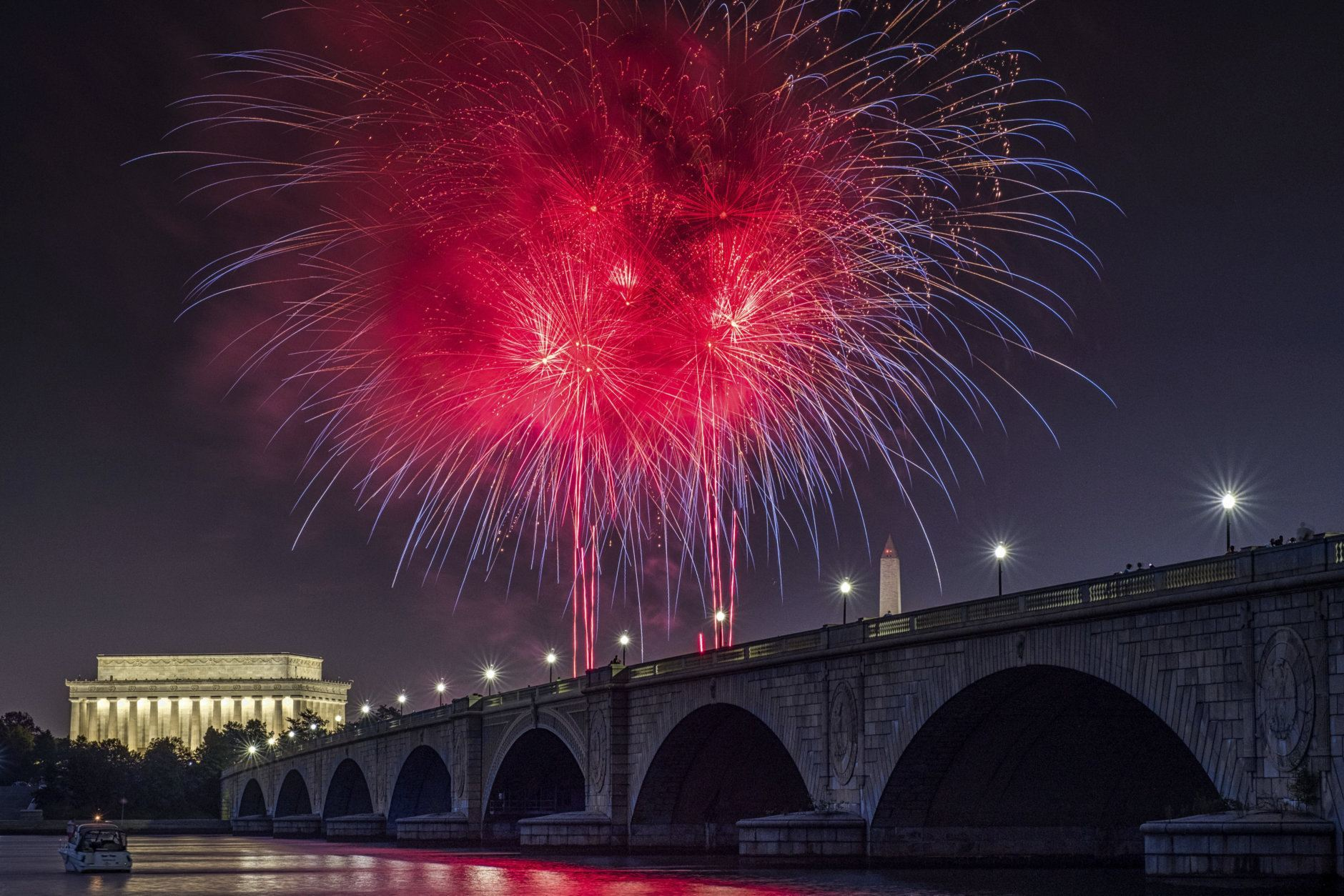 Fireworks burst over the Memorial Bridge during Independence Day celebrations on the National Mall in Washington, Tuesday, July 4, 2017. (AP Photo/J. David Ake)