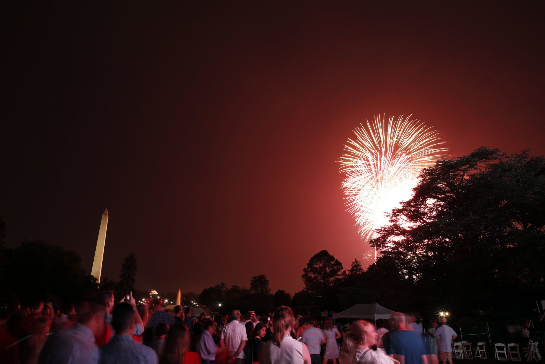 People watch fireworks on the National Mall from the South Lawn of the White House, Wednesday, July 4, 2018, in Washington. (AP Photo/Alex Brandon)