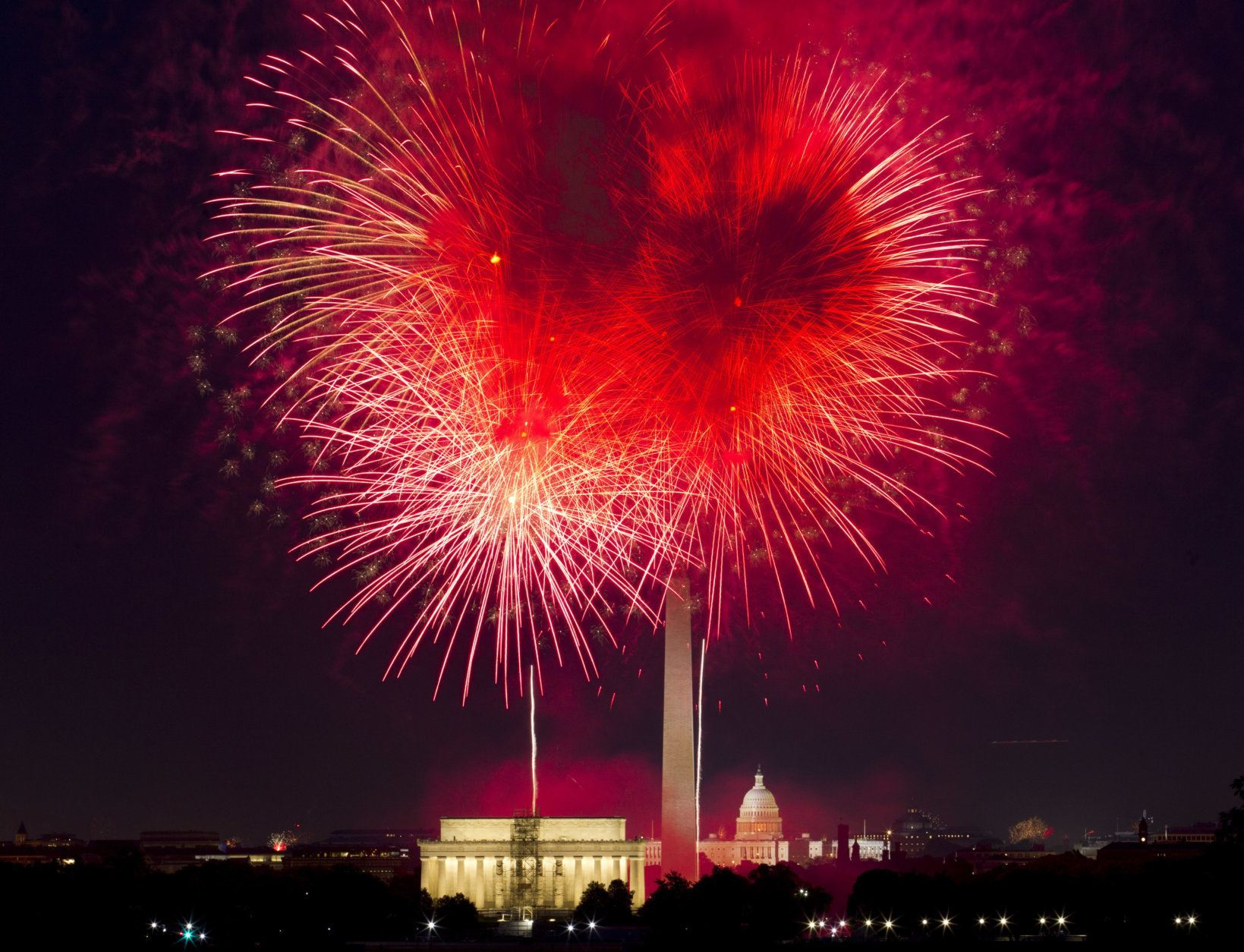 Fireworks explode over Lincoln Memorial, Washington Monument and U.S. Capitol, along the National Mall in Washington, Wednesday, July 4, 2018, during the Fourth of July celebration. (AP Photo/Jose Luis Magana)