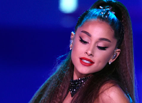 FILE - In this June 2, 2018 file photo., Ariana Grande performs at Wango Tango at Banc of California Stadium in Los Angeles. Grande is returning to Manchester, two years after a suicide bomber killed 22 people at her concert in the northwest England city. Organizers say Grande will be a headliner at the Manchester Pride Live event on Aug. 25.(Photo by Chris Pizzello/Invision/AP, File)