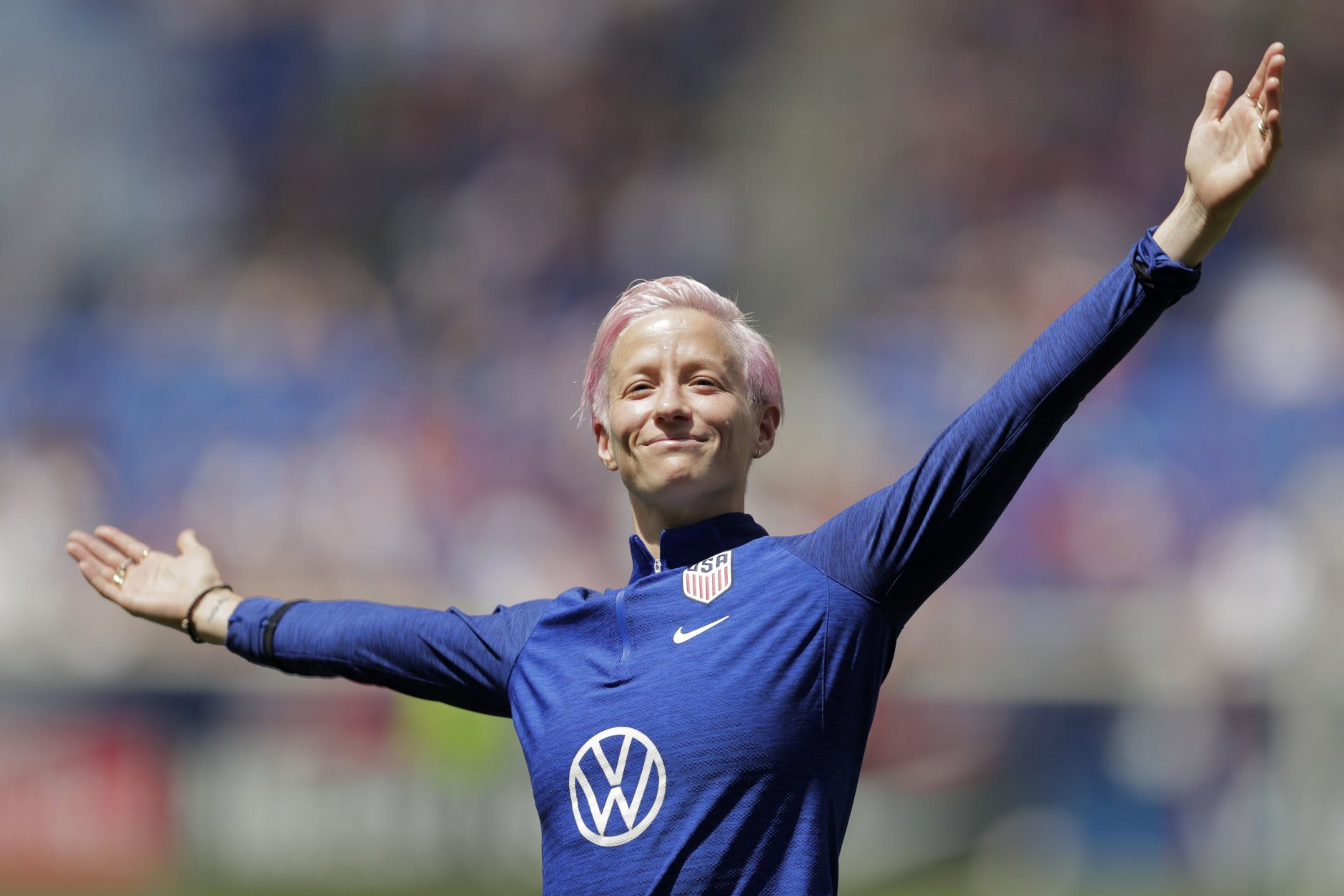 Megan Rapinoe, a forward for the United States women's national team, which is headed to the FIFA Women's World Cup, is introduced for fans during a send-off ceremony following an international friendly soccer match against Mexico, Sunday, May 26, 2019, in Harrison, N.J. The U.S. won 3-0. (AP Photo/Julio Cortez)