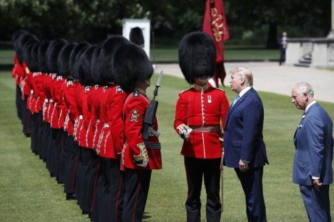 Ceremony, political gibes mark Trump's first day in London
