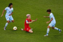 United States' Megan Rapinoe, centre, falls as Thailand's Kanjana Sung-Ngoen, left, and Ainon Phancha chase the gal during the Women's World Cup Group F soccer match between the United States and Thailand at the Stade Auguste-Delaune in Reims, France, Tuesday, June 11, 2019. (AP Photo/Francois Mori)