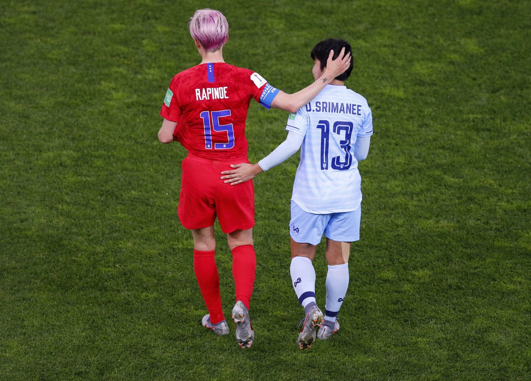 Thailand's Orathai Srimanee congratulates United States' Megan Rapinoe, left, after their Women's World Cup Group F soccer match between the United States and Thailand at the Stade Auguste-Delaune in Reims, France, Tuesday, June 11, 2019. The US defeated Thailand 13-0.(AP Photo/Francois Mori)