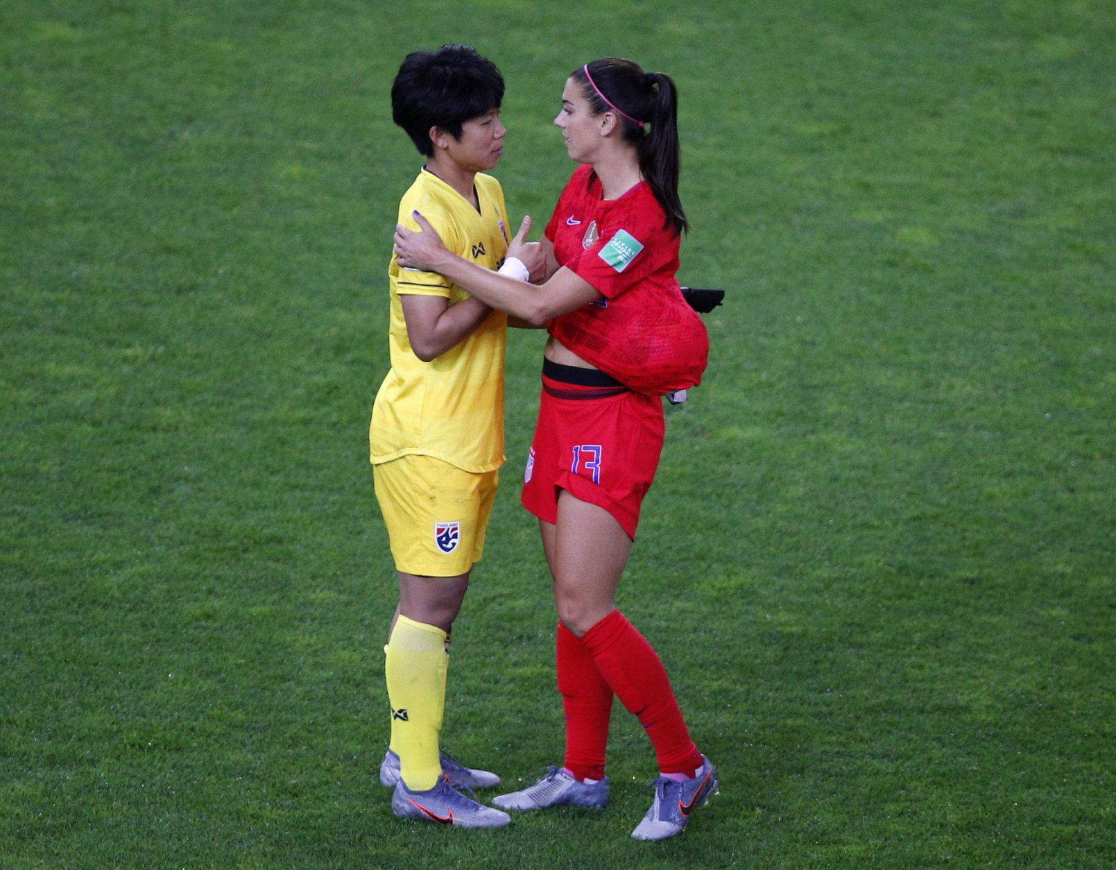 United States' Alex Morgan, right, talks with Thailand goalkeeper Waraporn Boonsing following their the Women's World Cup Group F soccer match between the United States and Thailand at the Stade Auguste-Delaune in Reims, France, Tuesday, June 11, 2019. The US defeated Thailand 13-0.(AP Photo/Francois Mori)