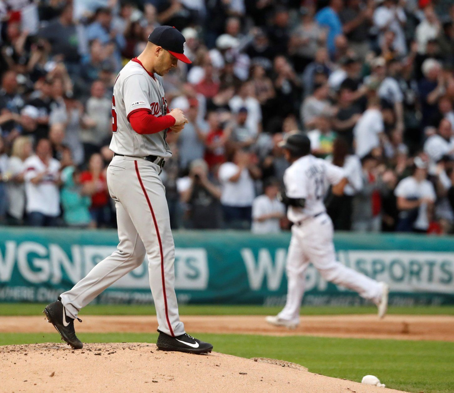 Washington Nationals starting pitcher Patrick Corbin, left, returns to the mound after giving up a grand slam to Chicago White Sox's Welington Castillo, background right, during the first inning of a baseball game Tuesday, June 11, 2019, in Chicago. (AP Photo/Charles Rex Arbogast)