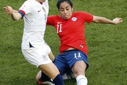 United States' Emily Sonnett vies for the ball with Chile's Yessenia Lopez, right, during the Women's World Cup Group F soccer match between the United States and Chile at the Parc des Princes in Paris, Sunday, June 16, 2019. (AP Photo/Thibault Camus)