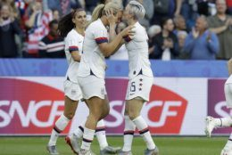 United States' Megan Rapinoe, right, kisses teammate and goal scorer Lindsey Horan during the Women's World Cup Group F soccer match between Sweden and the United States at Stade Océane, in Le Havre, France, Thursday, June 20, 2019. (AP Photo/Alessandra Tarantino)