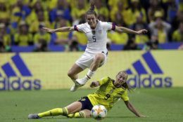 United States' Kelley O Hara leaps over Sweden's Kosovare Asllani during the Women's World Cup Group F soccer match between Sweden and the United States at Stade Océane, in Le Havre, France, Thursday, June 20, 2019. (AP Photo/Alessandra Tarantino)