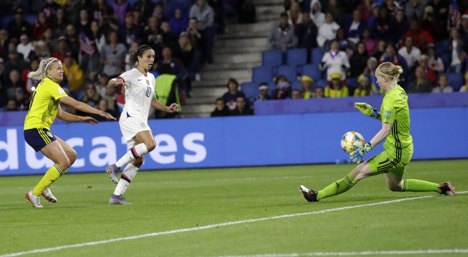 Sweden goalkeeper Hedvig Lindahl, right, blocks shot from United States' Carli Lloyd, centre, during the Women's World Cup Group F soccer match between Sweden and the United States at Stade Océane, in Le Havre, France, Thursday, June 20, 2019. (AP Photo/Alessandra Tarantino)
