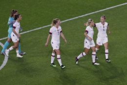 The United States players celebrate their victory at the end of the Women's World Cup Group F soccer match between the United States and Sweden at the Stade Oceane in Le Havre, France, Thursday, June 20, 2019. (AP Photo/Christophe Ena)