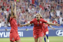United States' Christen Press, left, celebrates after scoring her side's first goal during the Women's World Cup semifinal soccer match between England and the United States, at the Stade de Lyon, outside Lyon, France, Tuesday, July 2, 2019. (AP Photo/Alessandra Tarantino)