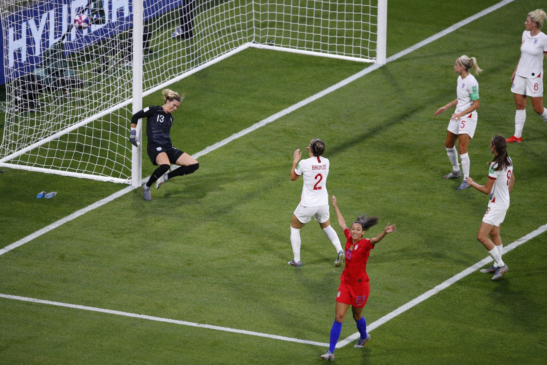 United States' Christen Press, bottom, reacts after scoring the opening goal of her team during the Women's World Cup semifinal soccer match between England and the United States, at the Stade de Lyon outside Lyon, France, Tuesday, July 2, 2019. (AP Photo/Francois Mori)