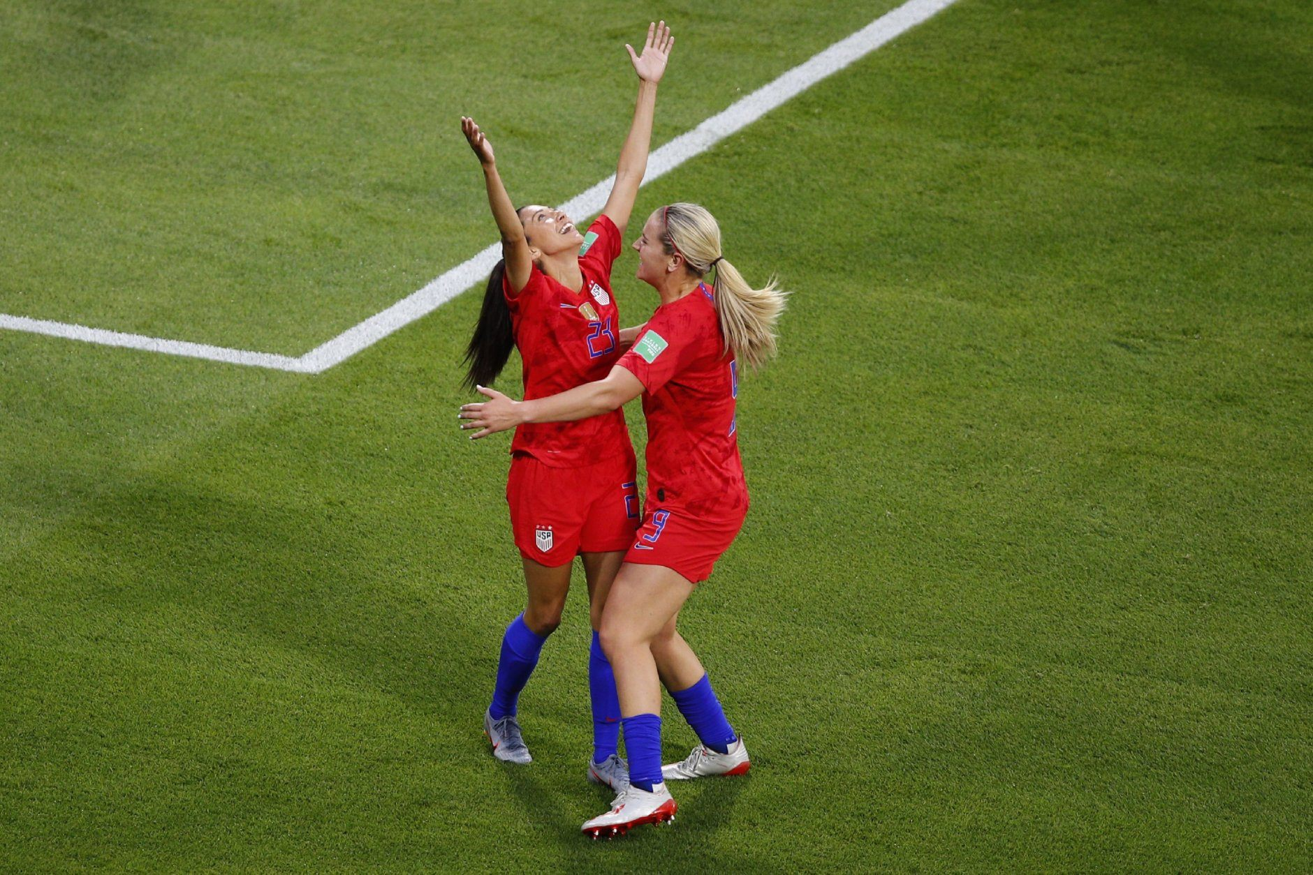 United States' Christen Press, left, reacts after scoring the opening goal of her team during the Women's World Cup semifinal soccer match between England and the United States, at the Stade de Lyon outside Lyon, France, Tuesday, July 2, 2019. (AP Photo/Francois Mori)