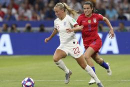 England's Beth Mead, left, and United States' Kelley O Hara challenge for the ball during the Women's World Cup semifinal soccer match between England and the United States, at the Stade de Lyon outside Lyon, France, Tuesday, July 2, 2019. (AP Photo/Laurent Cipriani)