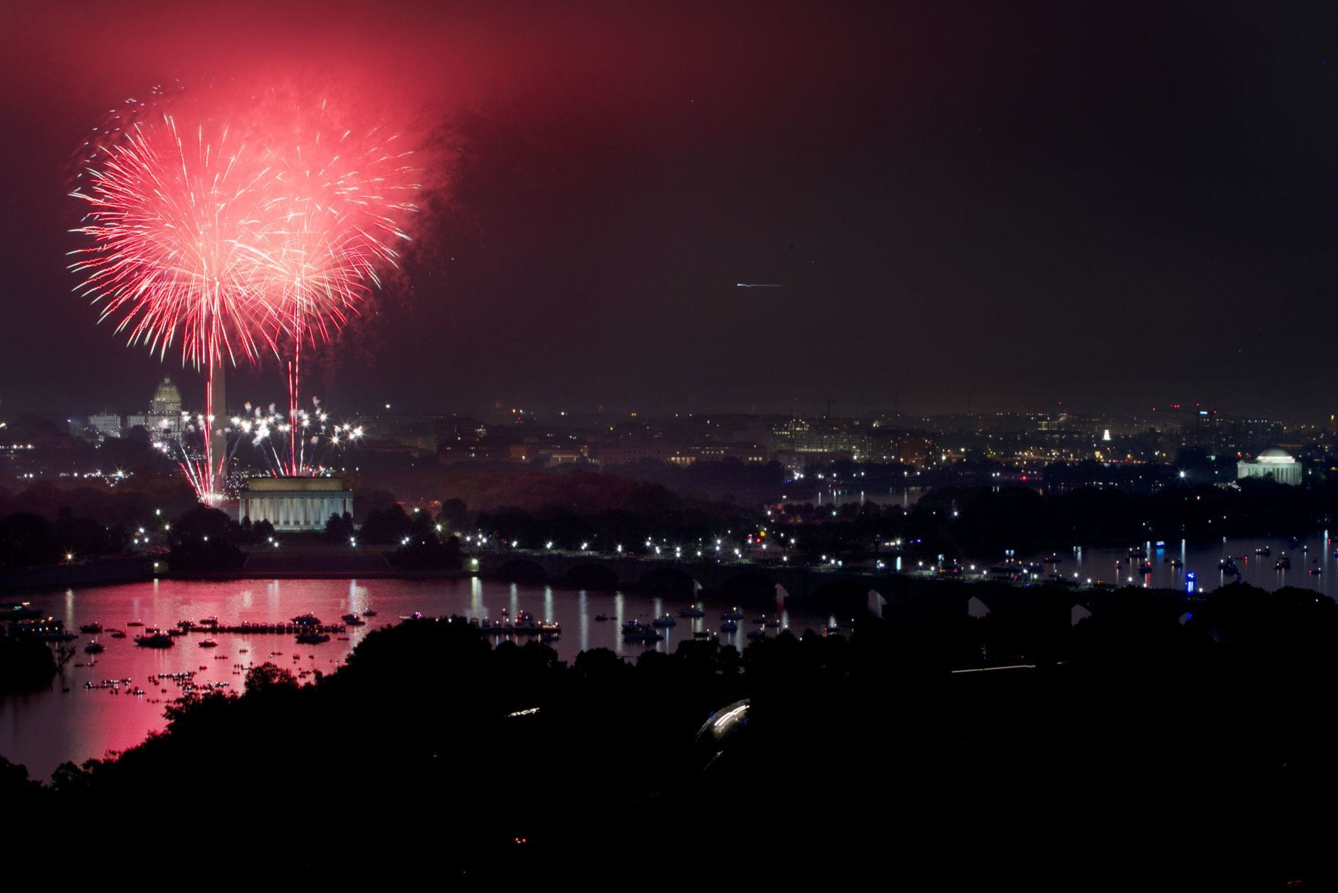 Fireworks explode over the National Mall for Fourth of July celebrations in Washington, photographed from Arlington, Va., on Saturday, July 4, 2015. (AP Photo/Jacquelyn Martin)