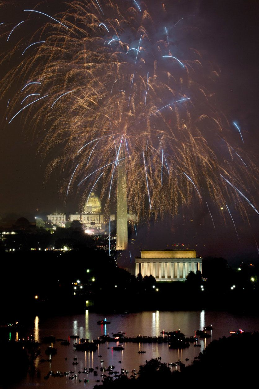 "Fireworks explode over the National Mall for Fourth of July celebration in Washington as seen from ""Top of the Town,"" a reception and conference facility in Arlington, Va., on Saturday, July 4, 2015. (AP Photo/Jacquelyn Martin)"
