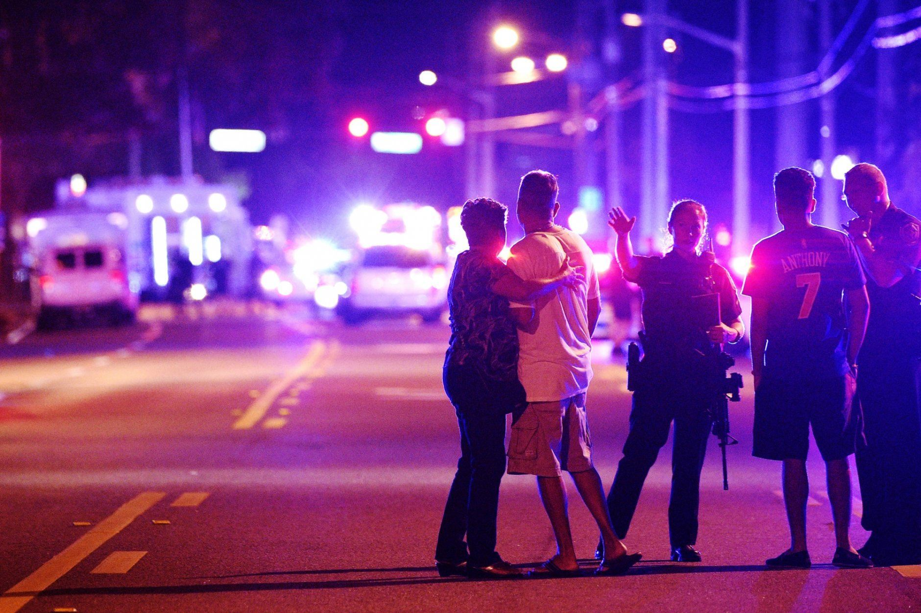 FILE - In this June 12, 2016 file photo, an Orlando Police officer directs family members away from a mass shooting at the Pulse nightclub in Orlando, Fla., that left 49 people dead. The shooter was killed by police after a three-hour standoff. After the tragedy, police were equipped with a new layer of body armor to stop rifle rounds. (AP Photo/Phelan M. Ebenhack, File)