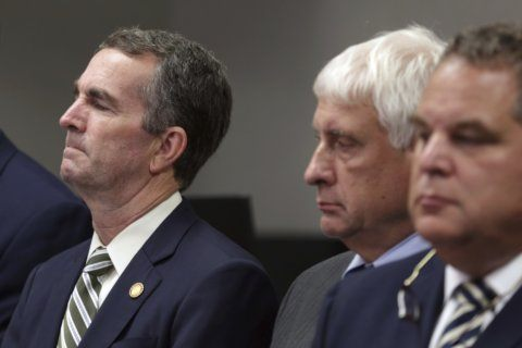 After massacre, Virginia governor demands action on guns