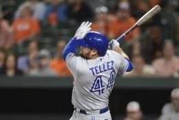 Toronto Blue Jays Rowdy Tellez follows through on a grand slam against the Baltimore Orioles during the fifth inning of a baseball game Wednesday, June 12, 2019, in Baltimore. (AP Photo/Gail Burton)