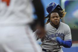 Toronto Blue Jays' Vladimir Guerrero advances to third after tagging up on a fly ball during the first inning of the team's baseball game against the Baltimore Orioles, Thursday, June 13, 2019, in Baltimore. (AP Photo/Gail Burton)