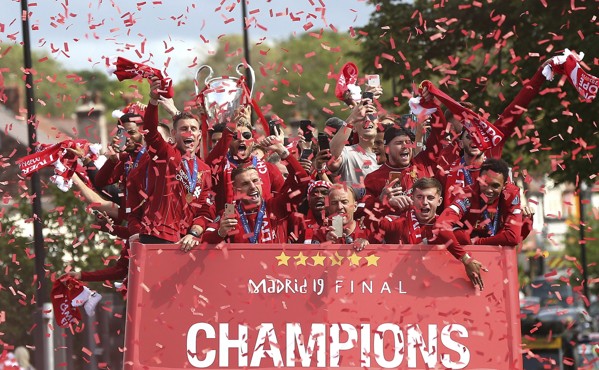 Liverpool celebrates Champions League win with bus parade ...