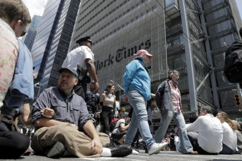 Climate change protesters arrested outside New York Times