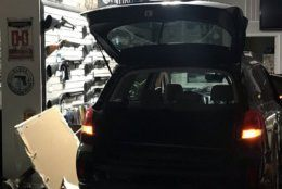 A suspect's vehicle is seen in a gun shop in Rockville after five suspects attempted to rob the store in the early morning hours of June 13, 2019. (Courtesy Montgomery County Police)