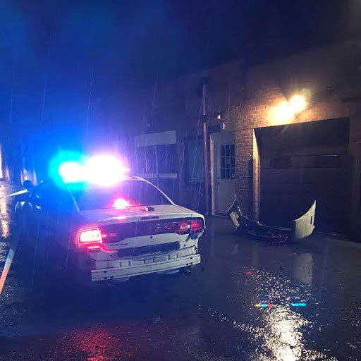 Damage to a police cruiser is seen after police say it was rammed by suspects following a burglary of the United Gun Store in Rockville. (Courtesy Montgomery County Police)