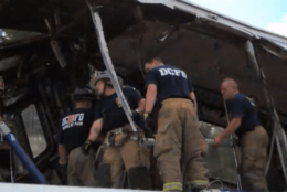 A screenshot from a DC Fire and EMS documentary shows Tony Carroll's crew on top of one of the railcars that crashed on the Red Line in 2009. (Courtesy DC Fire and EMS)