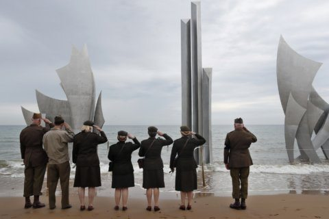 French beaches at dawn set scene for solemn D-Day observance