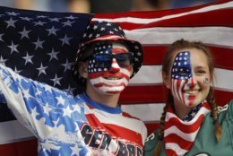 Siblings Austin, left, and Jordyn Chambers, from Philadelphia, hold up an US flag prior the Women's World Cup Group F soccer match between United States and Chile at Parc des Princes in Paris, France, Sunday, June 16, 2019. (AP Photo/Alessandra Tarantino)