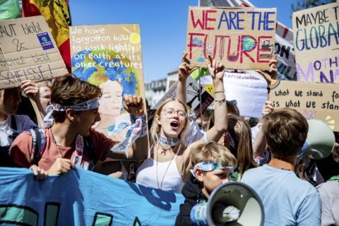 Thousands call for climate action, target German coal mine