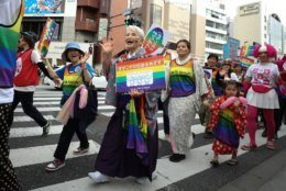TOKYO, JAPAN - APRIL 28: Participants walk down the street during the Tokyo Rainbow Pride Parade on April 28, 2019 in Tokyo, Japan. Thousands from the Japanese LGBT community and its supporters are expected to attend the annual Tokyo Rainbow Pride festival on April 28-29 in Yoyogi Park, with the Parade taking place on April 28th. The festival takes place during pride week, which runs through to May 6.  (Photo by Takashi Aoyama/Getty Images)