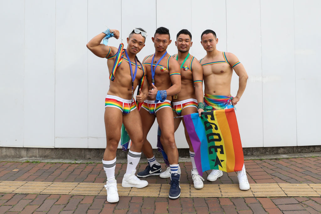 TOKYO, JAPAN - APRIL 28: Participants pose for a photograph during the Tokyo Rainbow Pride Parade on April 28, 2019 in Tokyo, Japan. Thousands from the Japanese LGBT community and its supporters are expected to attend the annual Tokyo Rainbow Pride festival on April 28-29 in Yoyogi Park, with the Parade taking place on April 28th. The festival takes place during pride week, which runs through to May 6.  (Photo by Takashi Aoyama/Getty Images)