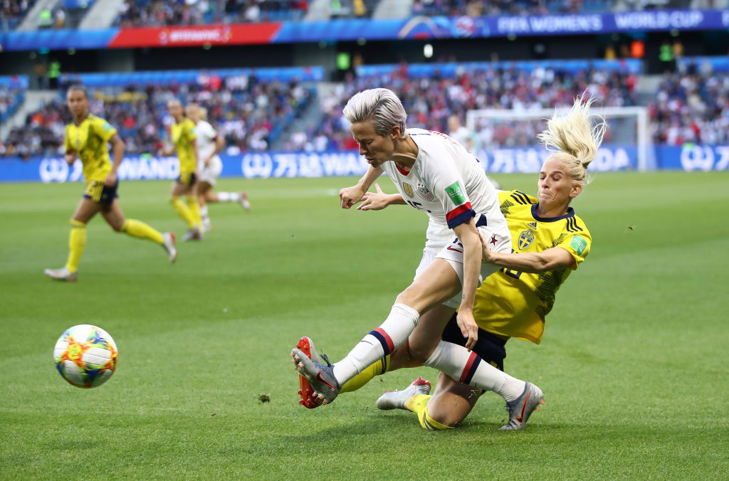 LE HAVRE, FRANCE - JUNE 20: Megan Rapinoe of the USA is challenged by Sofia Jakobsson of Sweden during the 2019 FIFA Women's World Cup France group F match between Sweden and USA at Stade Oceane on June 20, 2019 in Le Havre, France. (Photo by Alex Grimm/Getty Images)
