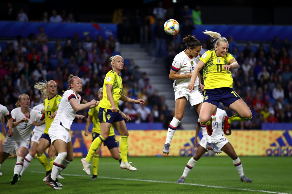LE HAVRE, FRANCE - JUNE 20: Carli Lloyd of the USA competes for a header with Stina Blackstenius of Sweden during the 2019 FIFA Women's World Cup France group F match between Sweden and USA at Stade Oceane on June 20, 2019 in Le Havre, France. (Photo by Alex Grimm/Getty Images)