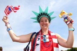 REIMS, FRANCE - JUNE 24: A USA fan poses for a photo outside the stadium prior to the 2019 FIFA Women's World Cup France Round Of 16 match between Spain and USA at Stade Auguste Delaune on June 24, 2019 in Reims, France. (Photo by Robert Cianflone/Getty Images)