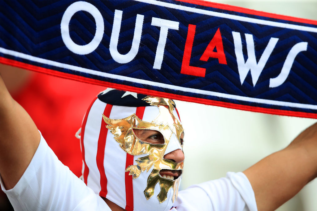 REIMS, FRANCE - JUNE 24: A USA fan wearing a mask shows their support prior to the 2019 FIFA Women's World Cup France Round Of 16 match between Spain and USA at Stade Auguste Delaune on June 24, 2019 in Reims, France. (Photo by Marc Atkins/Getty Images)