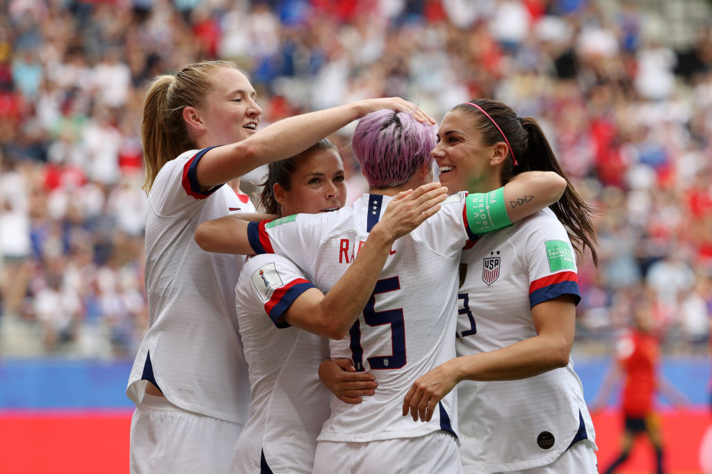 REIMS, FRANCE - JUNE 24: Megan Rapinoe of the USA celebrates with her team mates after scoring her sides first goal from the penalty spot during the 2019 FIFA Women's World Cup France Round Of 16 match between Spain and USA at Stade Auguste Delaune on June 24, 2019 in Reims, France. (Photo by Robert Cianflone/Getty Images)